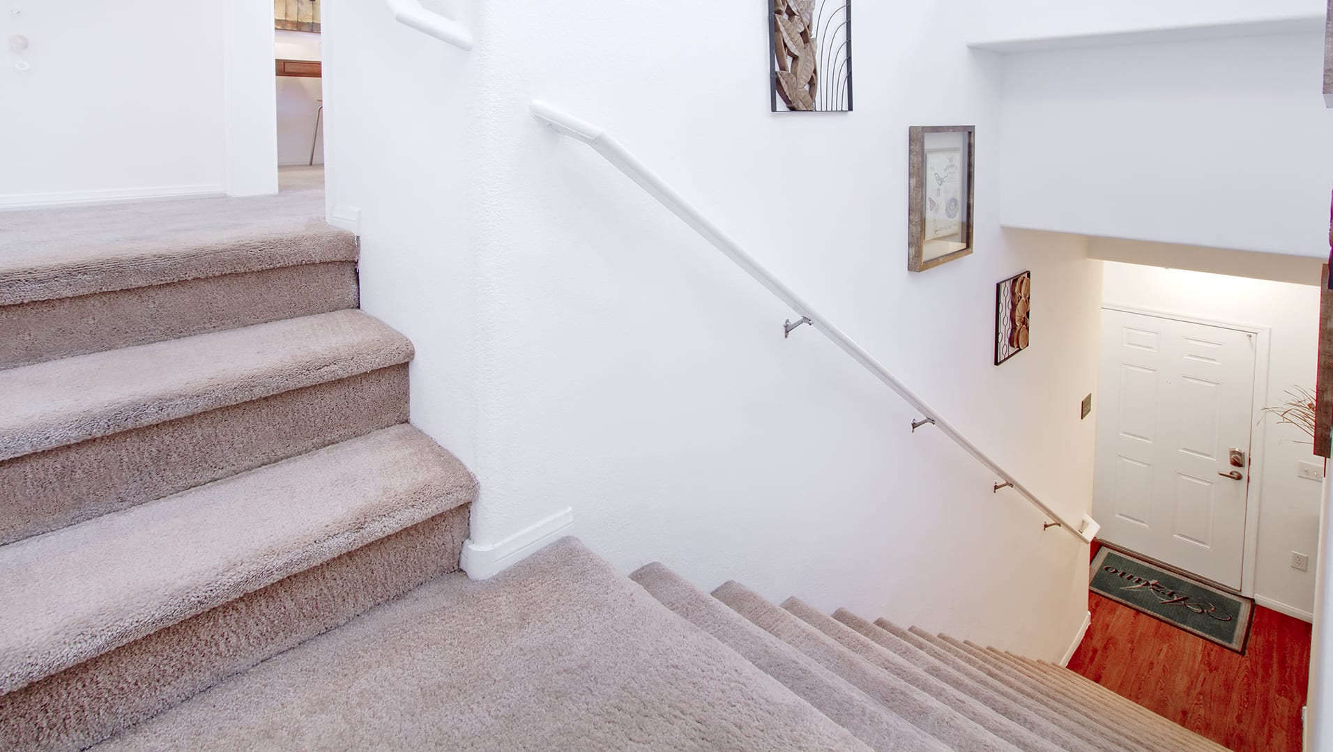 Carpeted interior staircase.