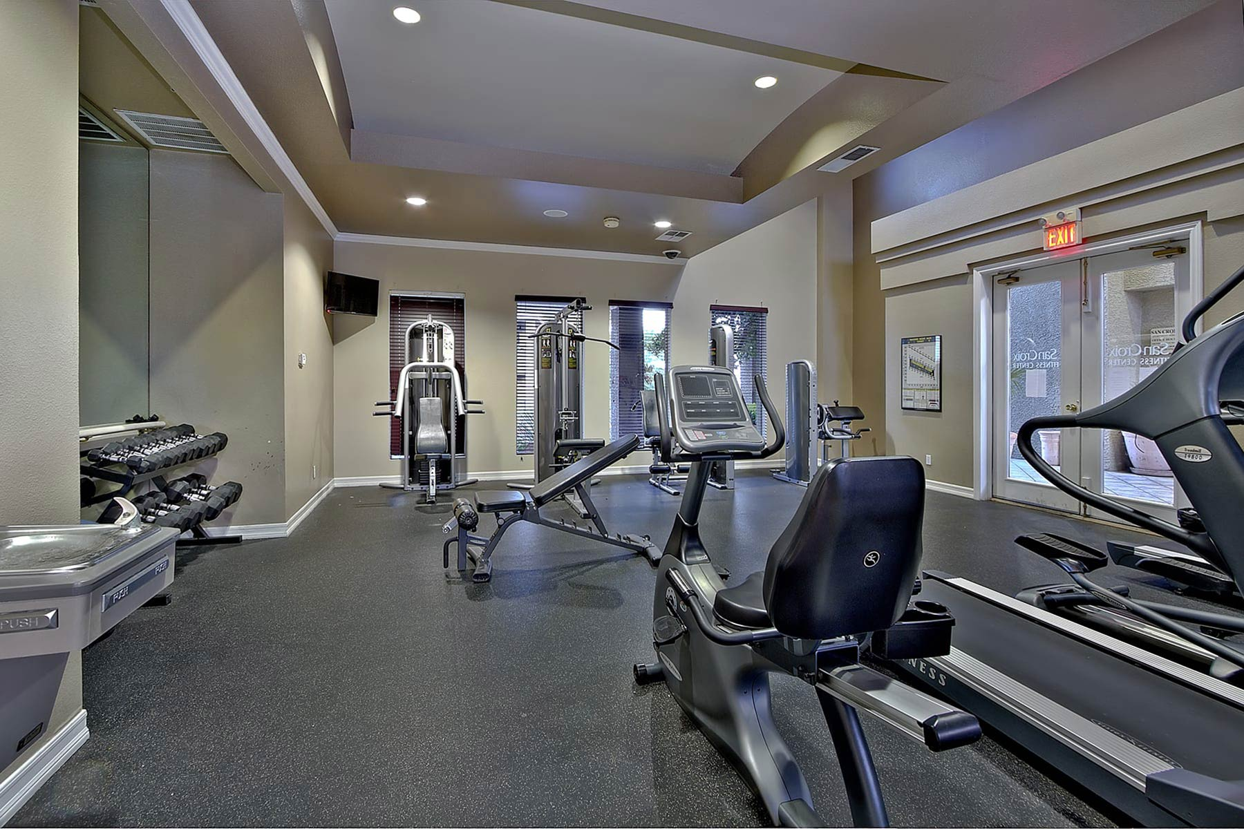 San Croix's fitness center with a selection of weight machines and cardio equipment.