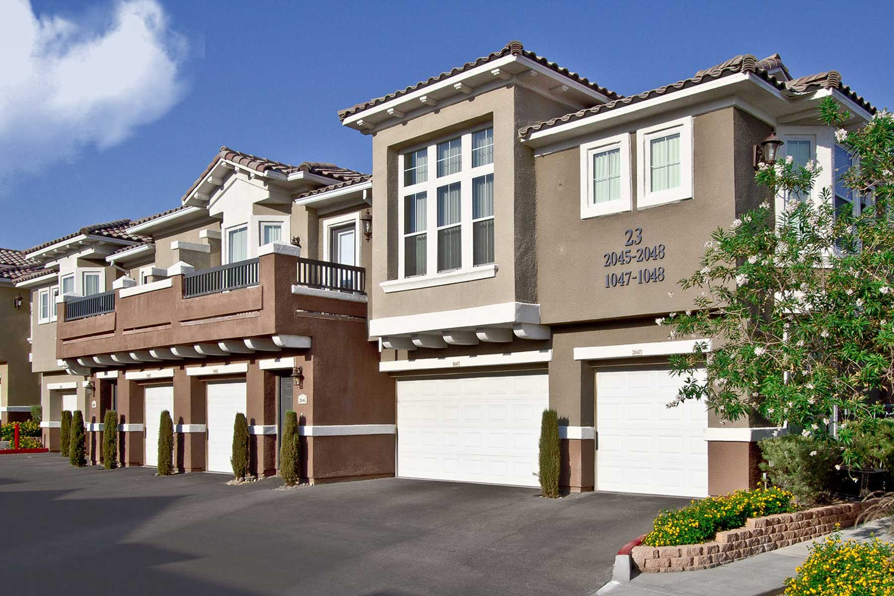Venicia apartment homes sit atop garages with a wide driveway.